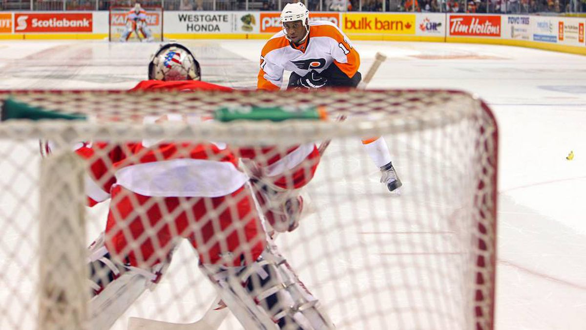 Philadelphia Flyers right wing Wayne Simmonds (17) skates in on net during the overtime shootout against the Detroit Red Wings as a banana lands on the ice at John Labatt Centre.
