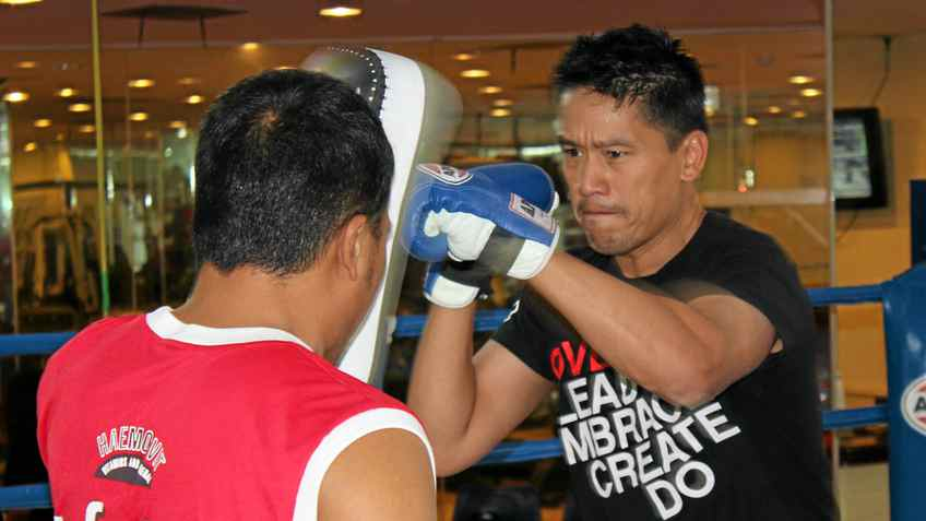 Bruce Poon throws punches at a boxing camp in Bangkok, Thailand.