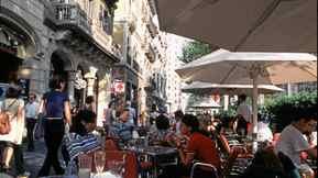People watch on Passeig de Gracia in Barcelona.