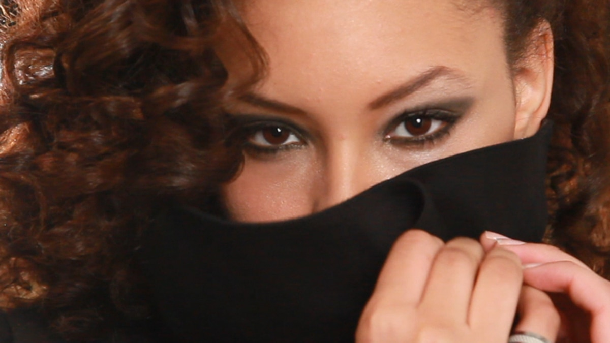A close-up shot of Royalz Clothing model sporting a black trench from the Fall 2011 line