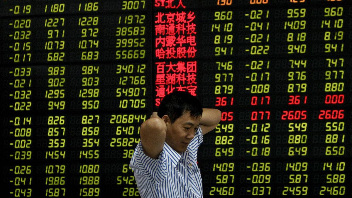 A Chinese investor in front of an electronic stock board at a brokerage house in Fuyang city in central China's Anhui province, Friday, Aug. 5, 2011.