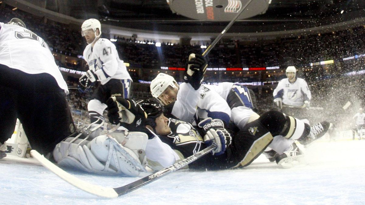 Pavel Kubina #13 of the Tampa Bay Lightning takes down Arron Asham #45 of the Pittsburgh Penguins. (Photo by Justin K. Aller/Getty Images)