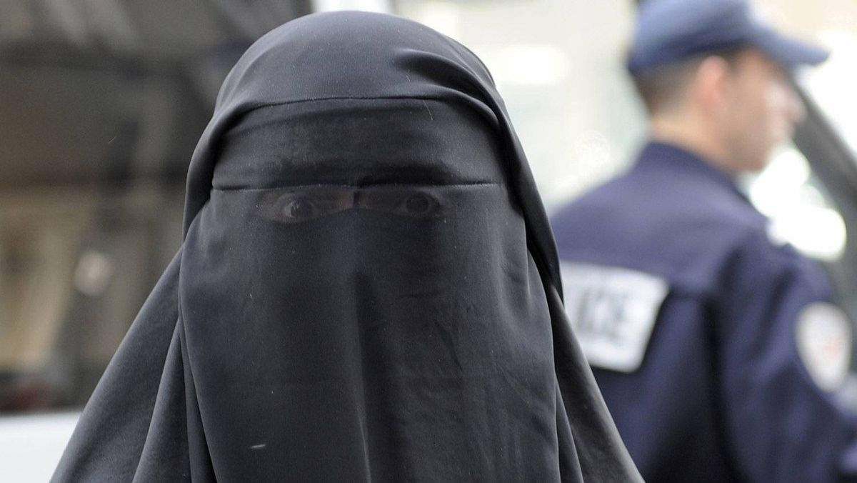 A woman in a burqa in France, where the niqab is banned.