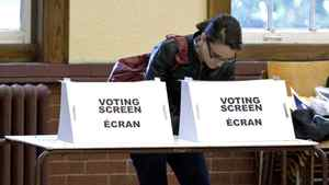 A woman casts her ballot in the Ontario election at a Toronto poling station on Oct. 6, 2011.