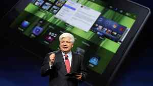 Mike Lazaridis, president and co-chief executive officer of Research in Motion, holds the Blackberry PlayBook