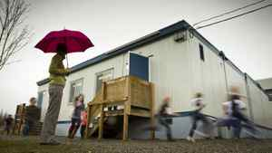 Students from Hazelwood School in Surrey run around the school portables during a break from class February 09, 2012.