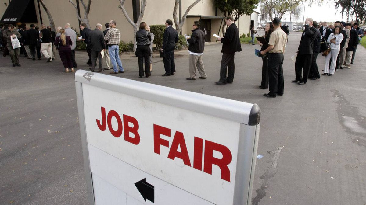 Hundreds of people wait in line at a job fair presented by Jobs & Careers Newspaper and Job Fairs in San Mateo, Calif.