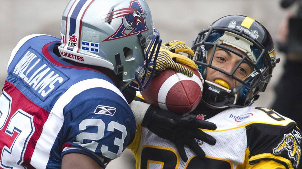 Montreal Alouettes Seth Williams interrupts a pass intended for Hamilton Tiger-Cats Chris Williams during the second half of their CFL football game in Montreal.
