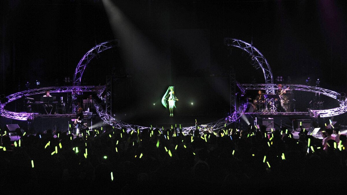 Computer-generated pop star Hatsune Miku is projected on a screen during her concert in Tokyo in this handout photo taken on March 8, 2012. Hatsune Miku has a following that would make most Japanese pop stars green with envy. But then she doesn't really exist.