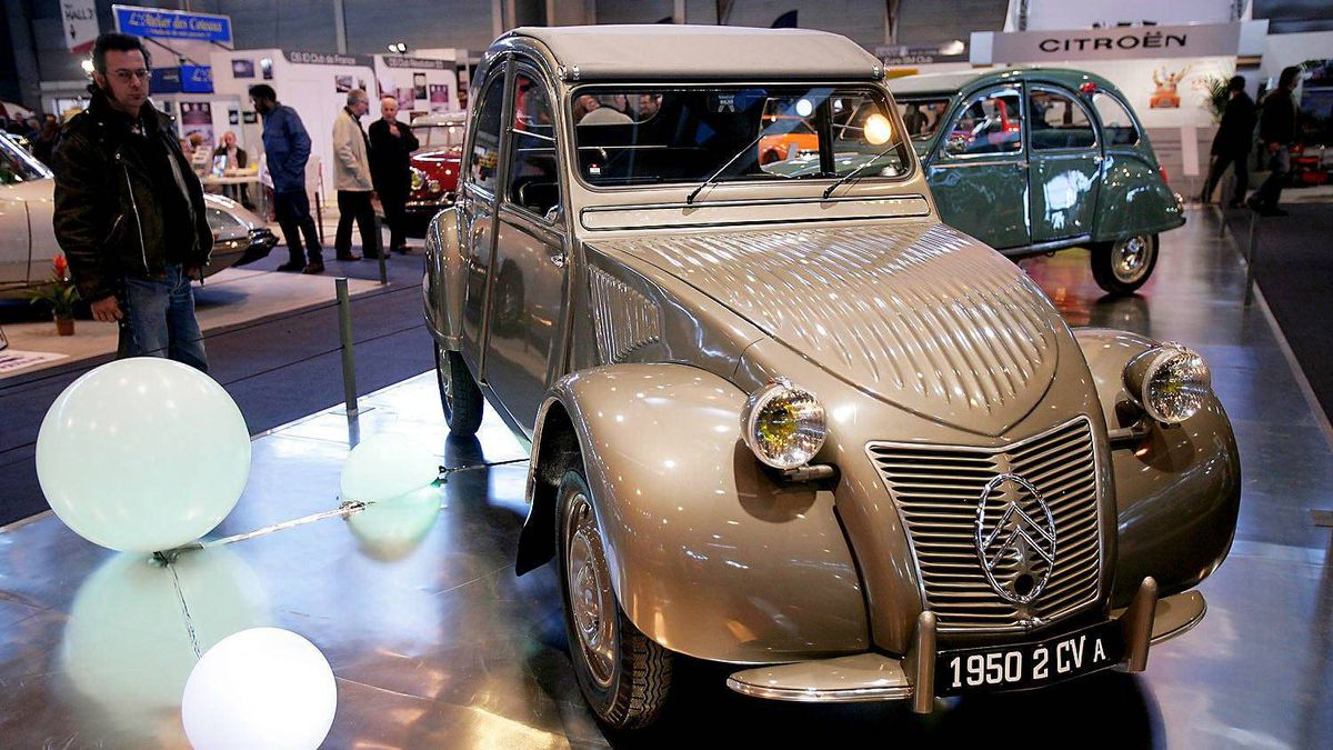 A 1950 Citroen 2CV on display at a Retromobile show in Paris, France in 2008. Note the flip-up side windows, which designers chose because they were lighter and cheaper than roll-up versions.