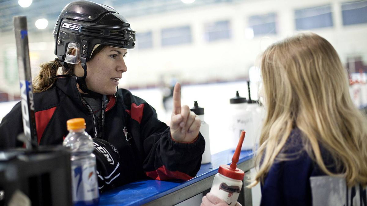 Canadian hockey gold medalist Katie Weatherston in Rockland, Ontario March 16, 2011. Katie tracks the eye movement of a girl who hit her head while on the ice and complained of headaches and dizziness.