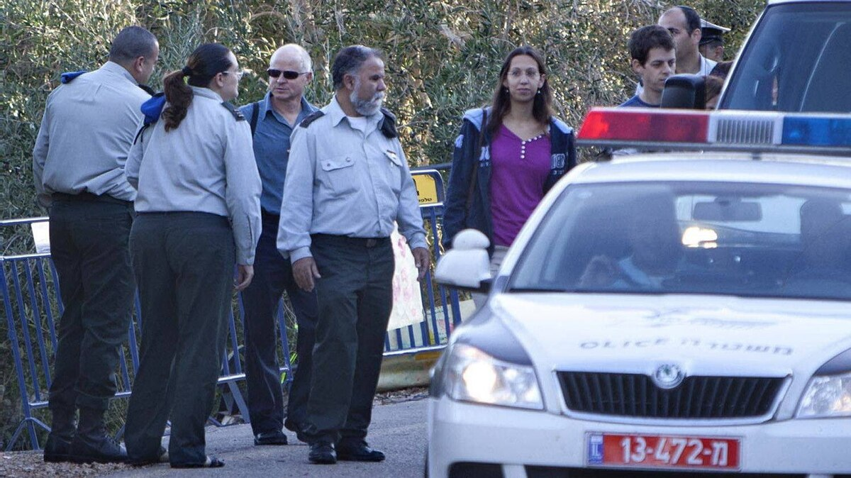Noam Schalit, father of captured Israeli soldier Gilad Schalit, centre with black sunglasses, leaves his house in Mitzpe Hila, northern Israel, on Oct. 18, 2011.