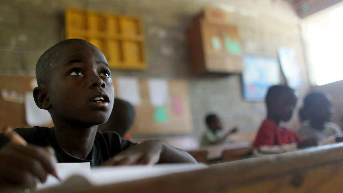 Students attend a class inside the Plein Soleil all-boys elementary school in Port-au-Prince on the first day schools were allowed to re-open after the earthquake in Haiti. Mario Tama/Getty Images