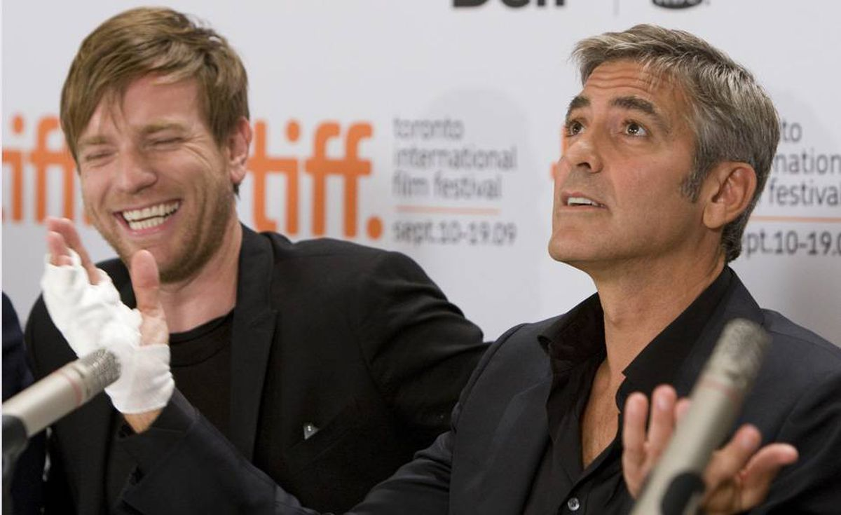 "Ewan McGregor (left) laughs at George Clooney's reaction to a question at the news conference for the movie ""Men Who Stare at Goats."""