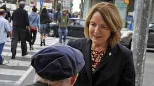 Parkdale-High Park MP Peggy Nash chats with a constituent in Toronto on Sept. 30, 2011.