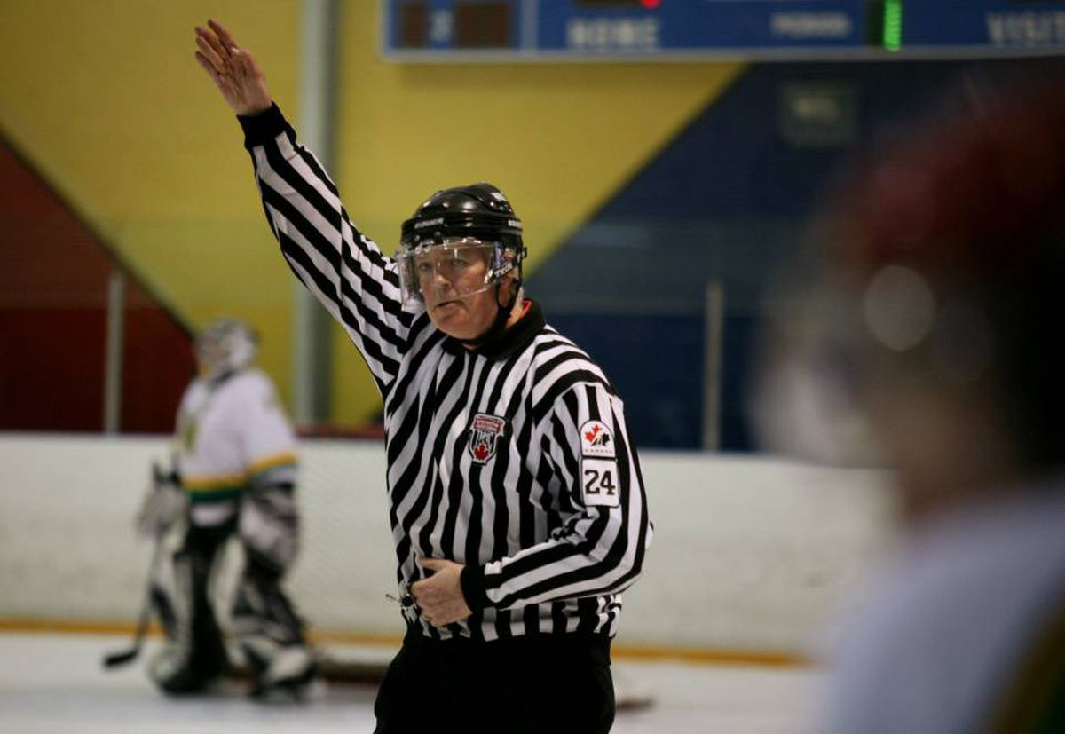 Peter Coleman, the referee-in-chief at True North Hockey makes a call during a game.