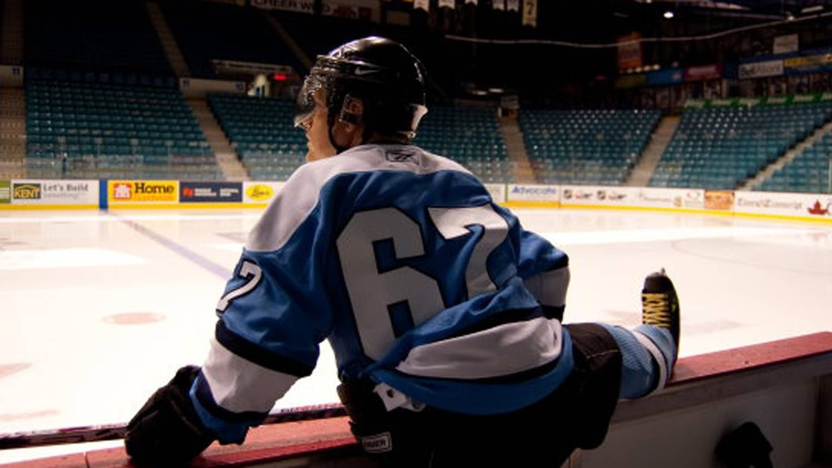 PropertyGuys' Ken LeBlanc stretches at the Moncton Coliseum before playing in a Property Guys-sponsored gentlemen's hockey league. He wears No. 67, for the last year the Maple Leafs won the Stanley Cup and the year he was born.