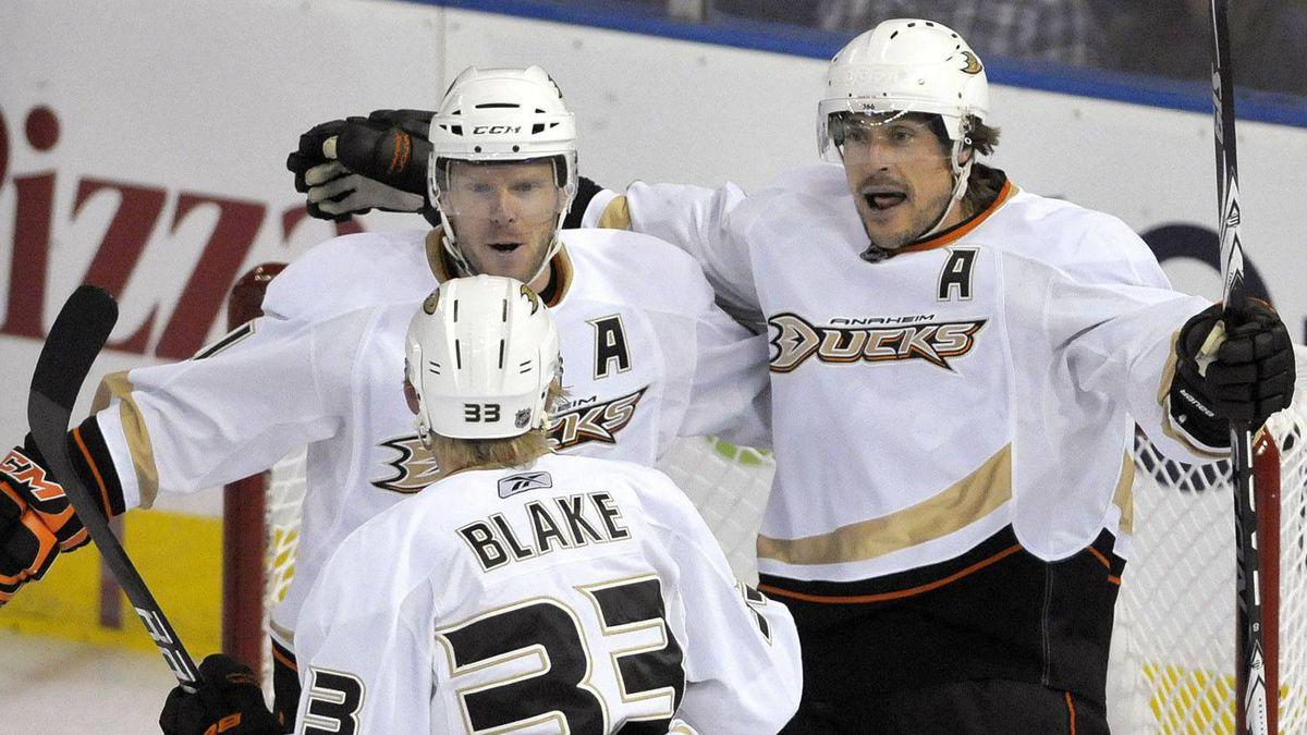 Anaheim Ducks' Saku Koivu (L), Jason Blake and Teemu Selanne (R) celebrate a goal against the Edmonton Oilers during the first period of their NHL hockey game in Edmonton February 13, 2011. The Ducks won 4-0. REUTERS/Dan Riedlhuber
