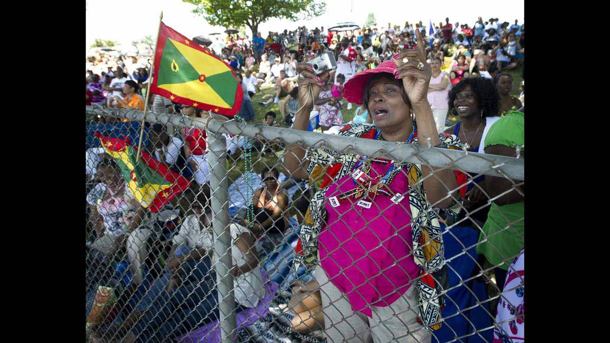 Crowds celebrate along the Caribbean Carnival parade route.