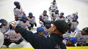 Head coach Gary Hunter talks to his players on Vancouver Thunderbirds Atom A2 during their game against Richmond Seafair A2 in Richmond, British Columbia, Canada September 29, 2011.