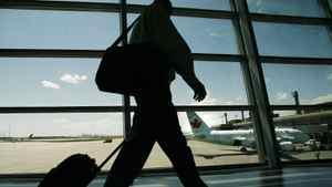 A passenger departs Calgary International Airport
