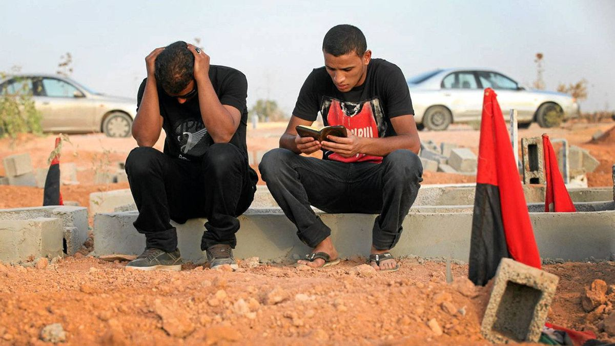 Khayralla Al-Ammari, 22, and Firas Busnayna, 21, sit over the plot of Mr. Busnayna's 24-year-old cousin.