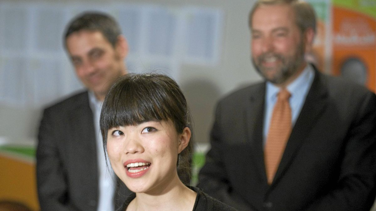 Newly-elected NDP MP Laurin Liu speaks to reporters during a post-election news conference in Montreal, Tuesday, May 3, 2011, as fellow MP Pierre Nantel and NDP deputy leader Thomas Mulcair, right, look on.