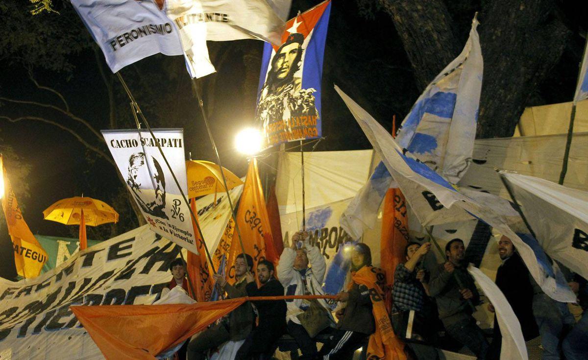 Supporters of Ecuador's President Rafael Correa hold a rally in Buenos Aires as Latin American leaders condemned unrest in Ecuador. Enrique Marcarian/Reuters