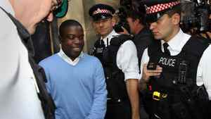 UBS equities trader Kweku Adoboli (C) leaves City of London Magistrates Court in central London, on September 16, 2011.
