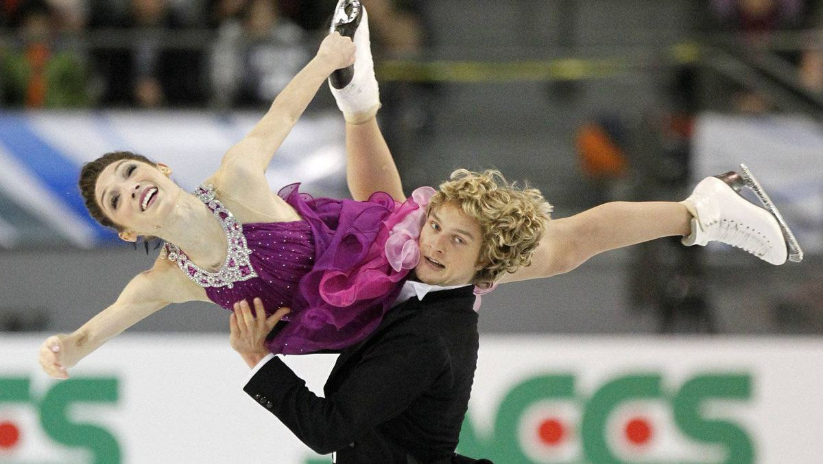 Meryl Davis and Charlie White of the U.S. skate during the ice dance free skate program at the International Skating Union (ISU) Grand Prix of Figure Skating Finals at the Pavillon de la Jeunesse in Quebec City, December 11, 2011. Davis and White won the competition. REUTERS/Mathieu Belanger