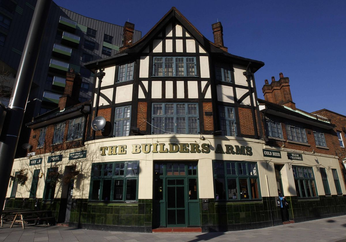 The Builders Arms pub is seen in east London. The pub is frequented by workers from the Olympic site but only after work as alcohol is forbidden by the authorities during work hours.