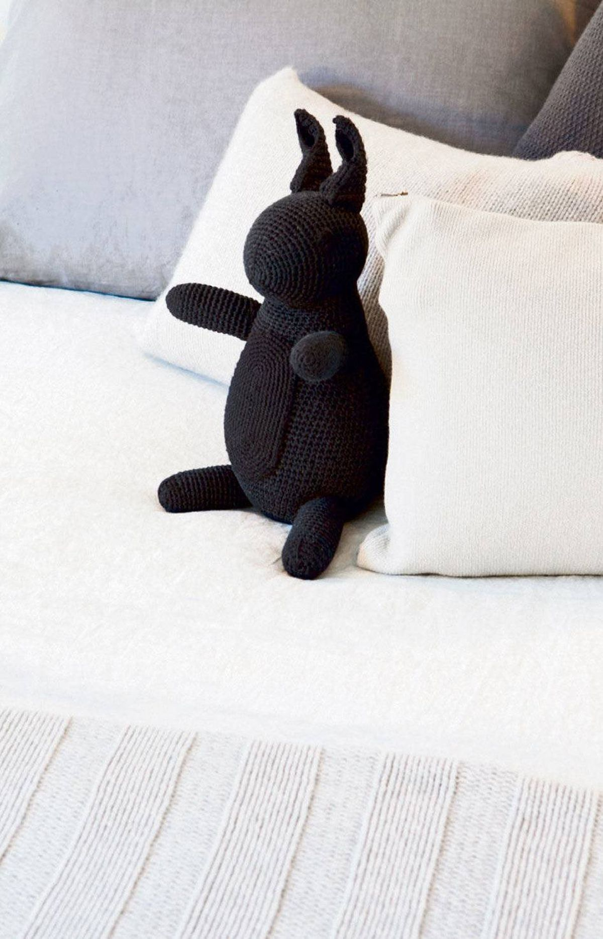 The stuffed cotton rabbit, a gift to Melissa from a friend, adds a touch of whimsy to the quasi-minimalist space.