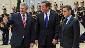 Prime Minister Stephen Harper and his British counterpart, David Cameron, are greeted by French President Nicolas Sarkozy ahead of a summit on Libya's future in Paris on Sept. 1, 2011.