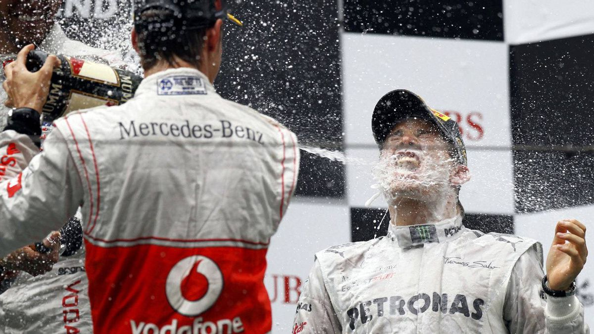 Mercedes Formula One driver Nico Rosberg of Germany is sprayed with champagne during the podium ceremony following the Chinese F1 Grand Prix at Shanghai International circuit April 15, 2012. Rosberg won the Chinese Grand Prix for Mercedes from pole position on Sunday in the first victory of his 111-race Formula One career. Button finished second for McLaren with team mate and compatriot Hamilton finishing third for the third race in a row to take the championship lead. REUTERS/David Gray