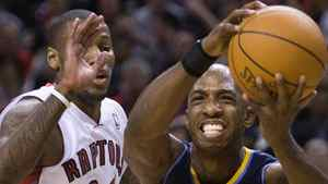 Toronto Raptors forward Sonny Weems, left, battles for the ball against Denver Nuggets guard Chauncey Billups, right, during first half NBA basketball action in Toronto on Friday, December 10, 2010. THE CANADIAN PRESS/Nathan Denette