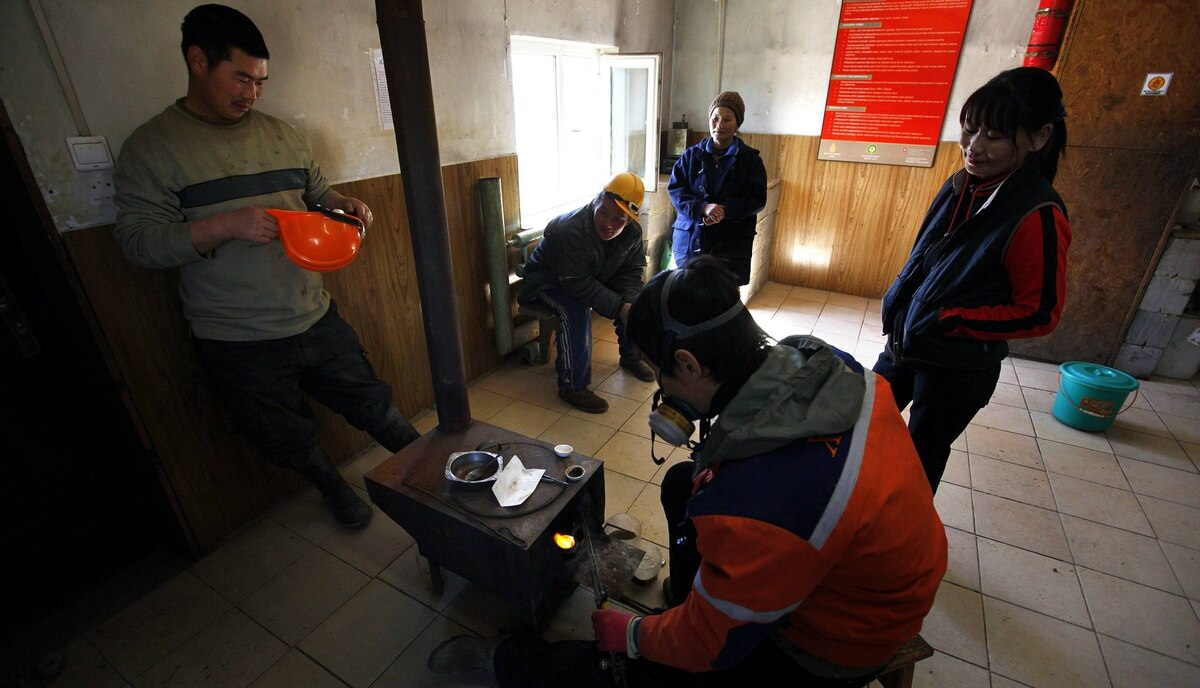 Small-scale miners wait for their gold to be melted into one piece before being weighed and sold at a processing plant located around 100 km north of the Mongolian capital city Ulan Bator.