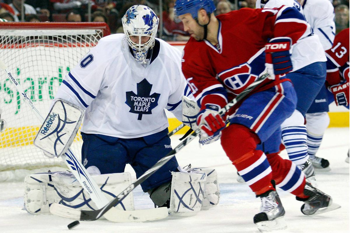 Jonas Gustavsson of the Toronto Maple Leafs gets down to stop the puck on an attempt by Glen Metropolit of the Montreal Canadiens on Tuesday night.