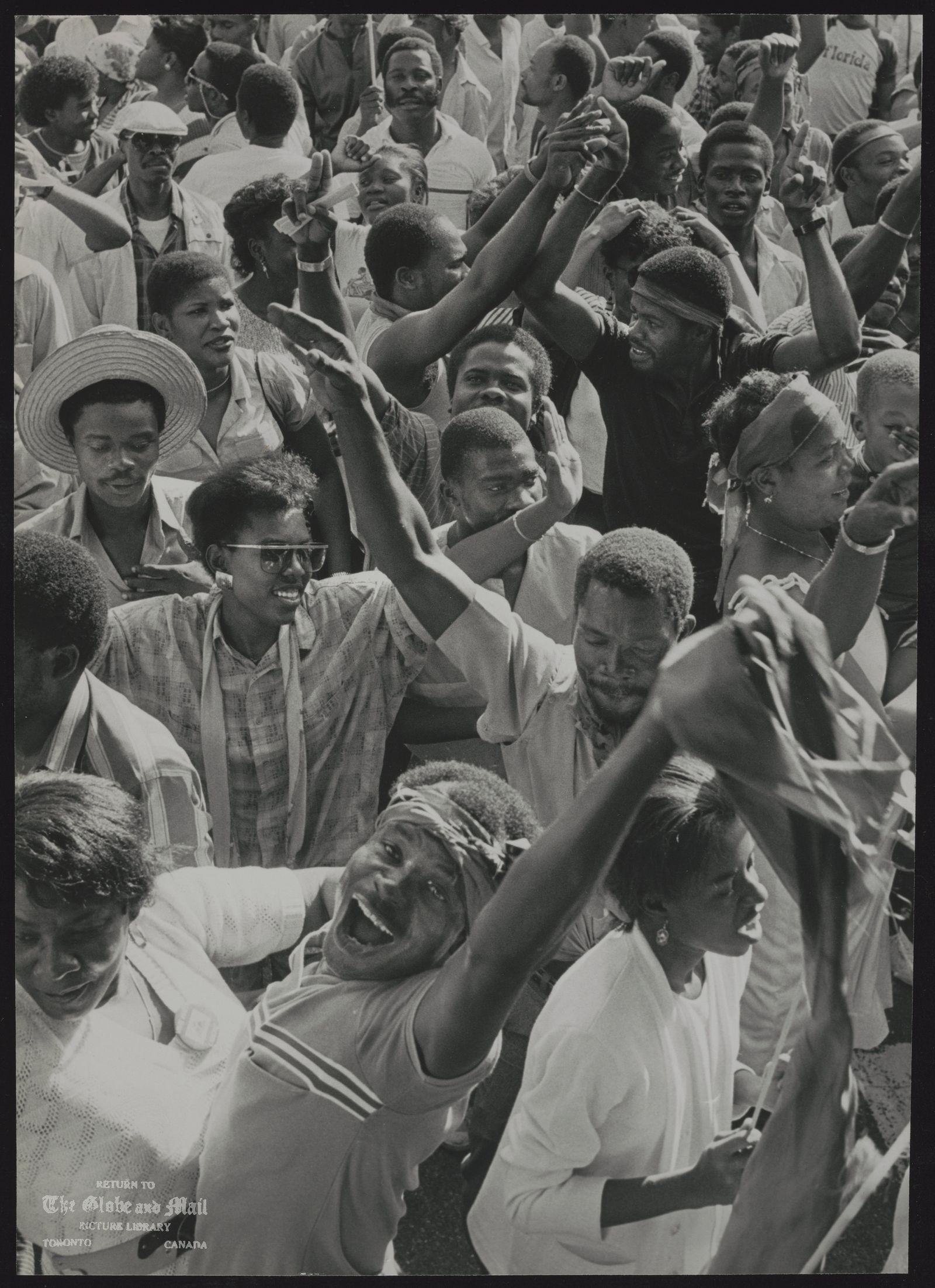 REFUGEES Haiti Haitians celebrating in Miami's Little Haiti, the departure of president for life Jean-Claude Duvalier. Photo: Tom Szlukovenyi Feb 7/86