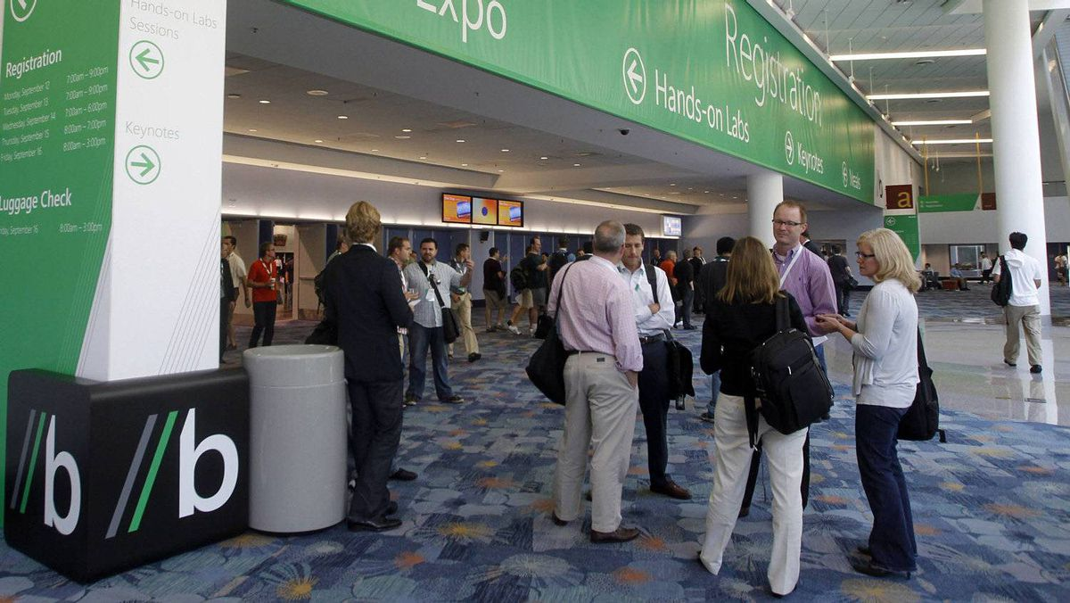 "Attendees wait near an entrance to the Microsoft ""Build"" developer conference in Anaheim, California September 13, 2011. Microsoft Corp handed out 5,000 sleek Samsung tablet computers running a test version of Windows 8 at its annual developer conference on Tuesday, hoping to stoke excitement over its new operating system."