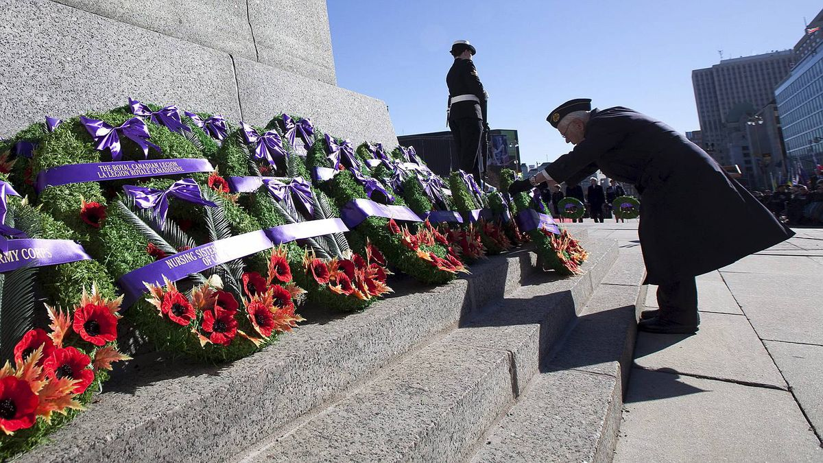 A veteran places a wreath during the Remembrance Day ceremony at the National War Memorial in Ottawa