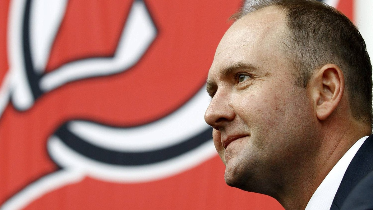 Peter DeBoer smiles while being announced as the new head coach of the New Jersey Devils, Tuesday, July 19, 2011, in Newark, N.J. (AP Photo/Julio Cortez)