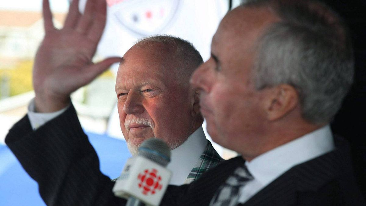"""Ron MacLean, right, and Don Cherry of CBC's Hockey Night in Canada entertain the crowd at the Robert French Memorial Stadium in Conception Bay South, N.L., prior to the Kraft Hockeyville 2011 competition on Sept.24, 2011. MacLean says Cherry is being treated unfairly over his season-opening """"Coach's Corner"""" blast against a trio of former enforcers and their take on fighting. THE CANADIAN PRESS/Paul Daly"""