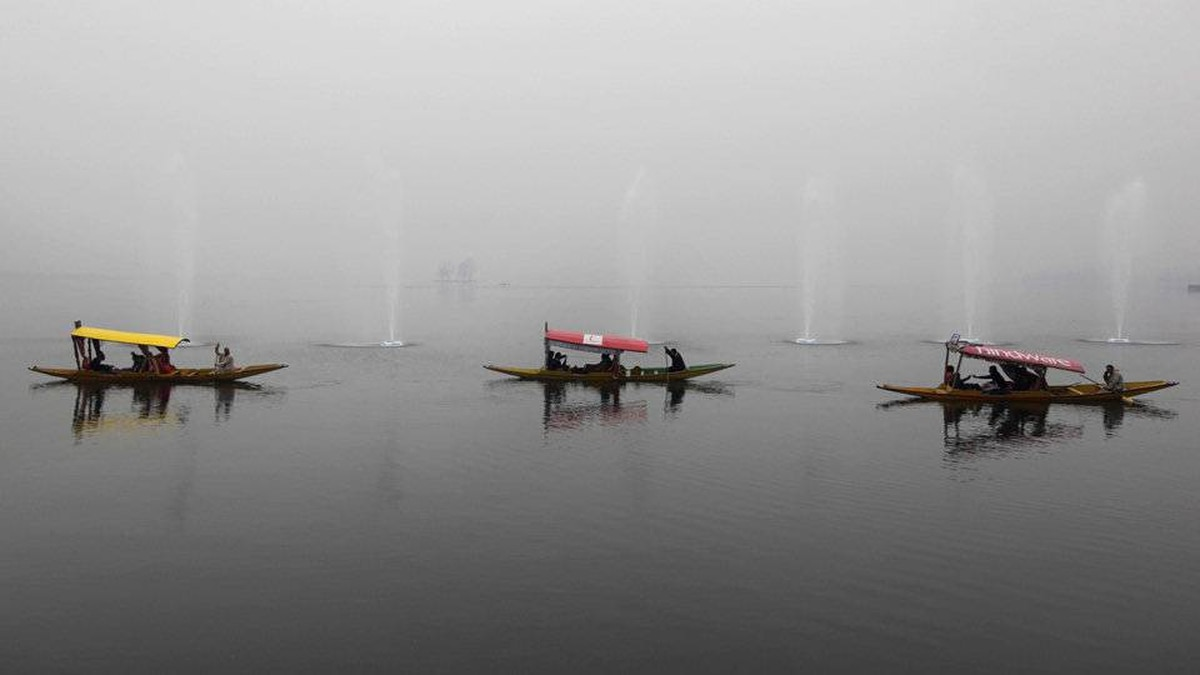 Tourists enjoy a ride on the Dal Lake on a foggy day in Srinagar, India, Wednesday, Jan. 4, 2012.