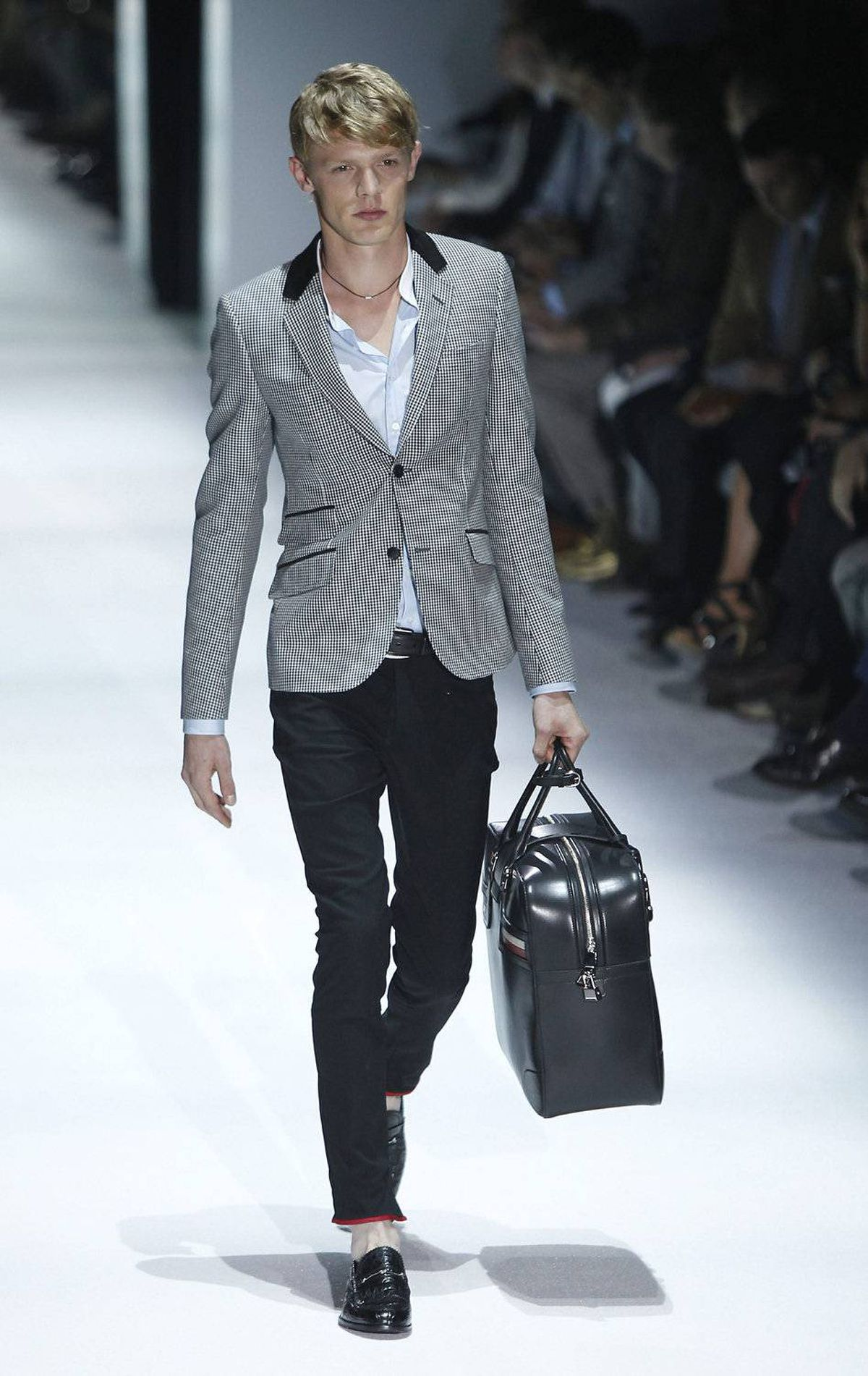 A model wears an outfit from the Gucci men's spring-summer 2012 collection, part of the Milan Fashion Week, on Monday, June 20, 2011.