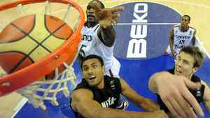 Canada's Joel Anthony (L, back) leaps to the net moments after New Zealand's Mika Vukona (L, front) scores next to teammate Thomas Abercrombie(R) during the Group D preliminary round match between Canada and New Zealand at the FIBA World Basketball Championships in Izmir, Turkey on September 1, 2010. New Zealand won Canada 71-61. Getty Images/ FRANCK FIFE