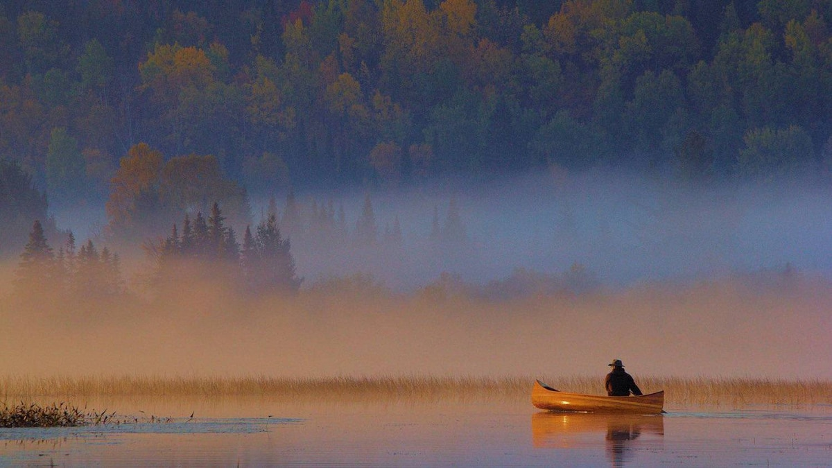 The first place winner of AO's Fall photo contest: 'Morning Mist Paddle,' which shows a paddler in the morning mist just off of Lake of Two Rivers Beach.