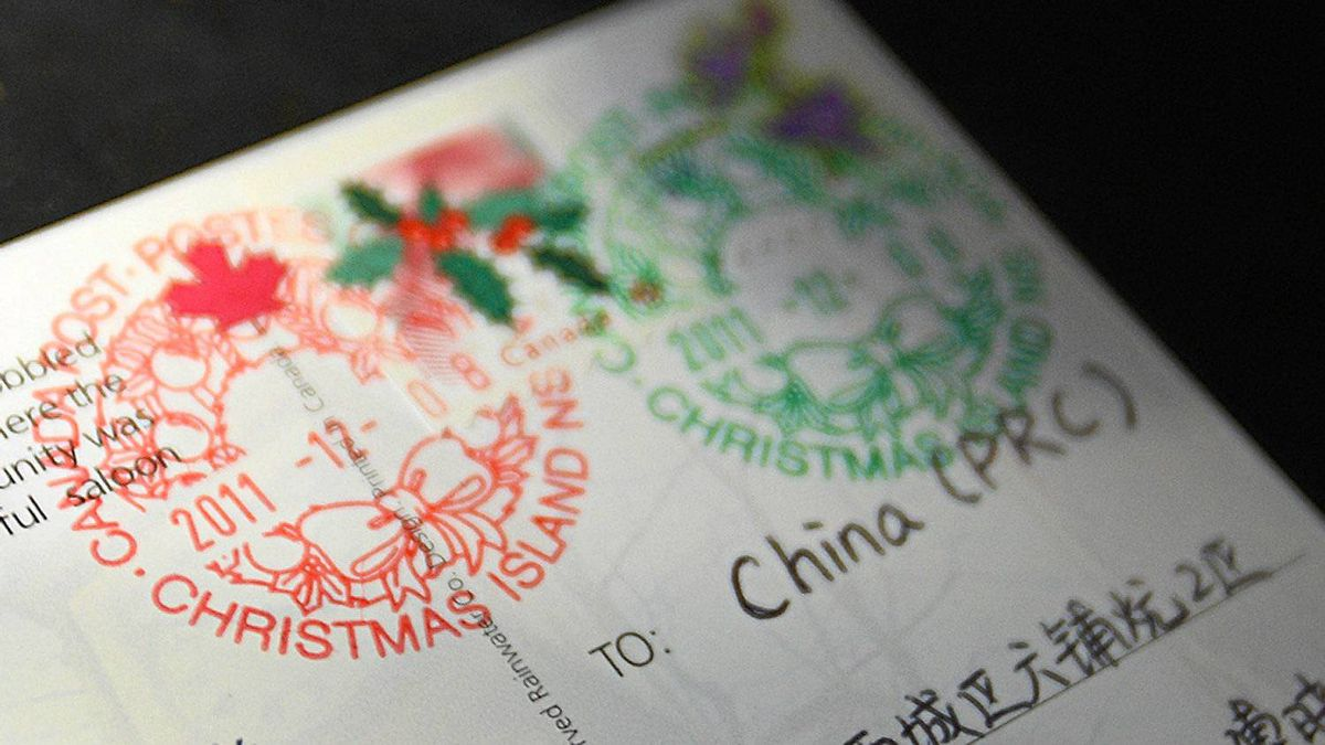 A card sent from British Columbia with a final destination to China shows the two distinctive Christmas wreath stamps which were affixed at the small post office at Christmas Island, Nova Scotia., December 8, 2011. Cards and letters arrive from around the world for the special postage stamp.