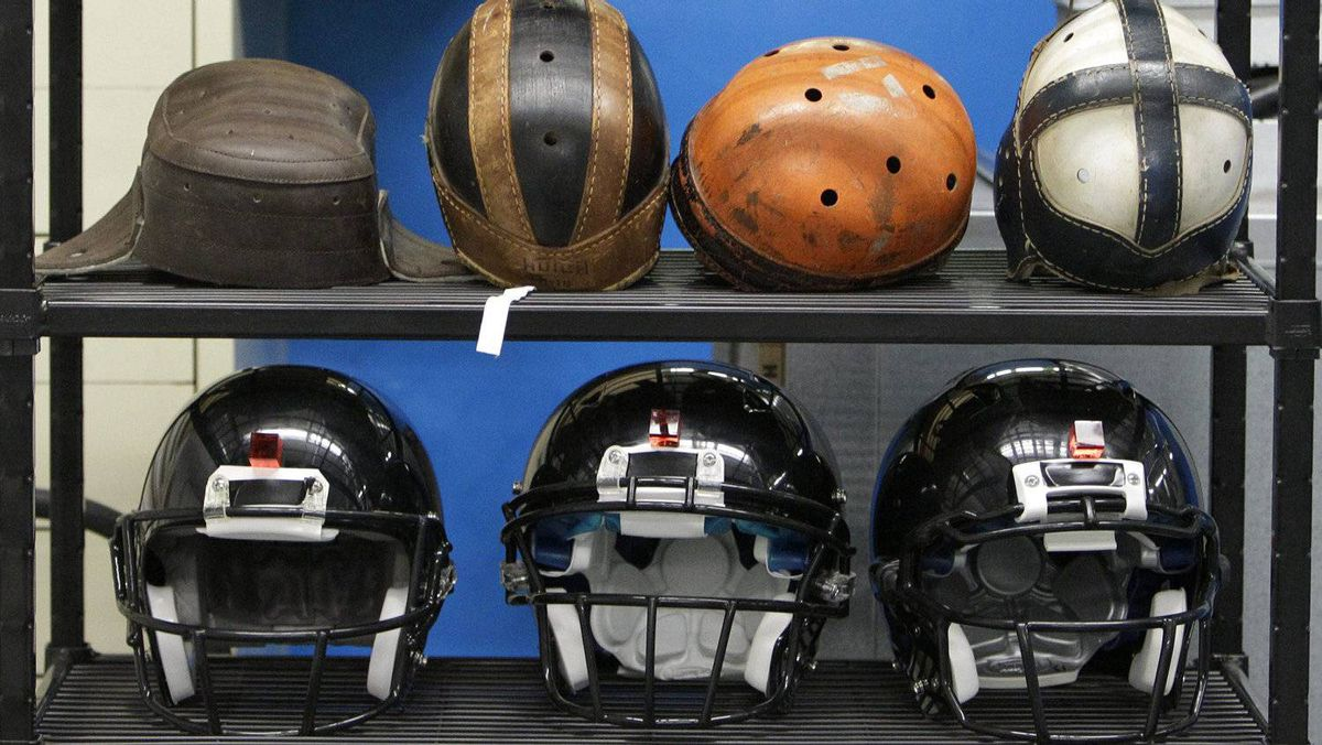 In this Sept. 23, 2010, file photo some football helmets used for testing helmet-to-helmet collisions are seen in a rack at a laboratory in the Cleveland Clinic's Lutheran Hospital. Sen. Tom Udall, D-N.M., and Rep. Bill Pascrell, D-N.J., introduced the Children's Sports Athletic Equipment Safety Act in March 2011. With sports concussions among the nation's young people a big issue in schools the bill would give the industry nine months to come up with new standards that address concussion risks and their specific needs. (AP Photo/Mark Duncan, File)