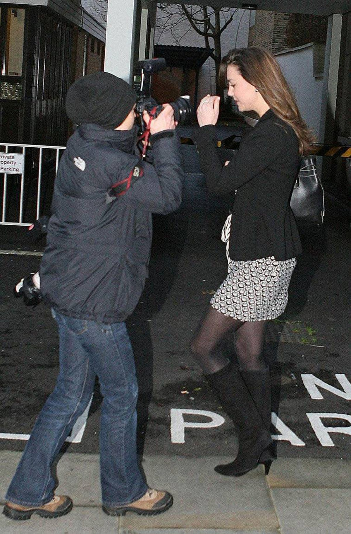 Kate Middleton is met by photographers outside her house in London on her 25th birthday Tuesday Jan. 9, 2007. Middleton made headlines for getting a parking ticket and on her fashion choices.