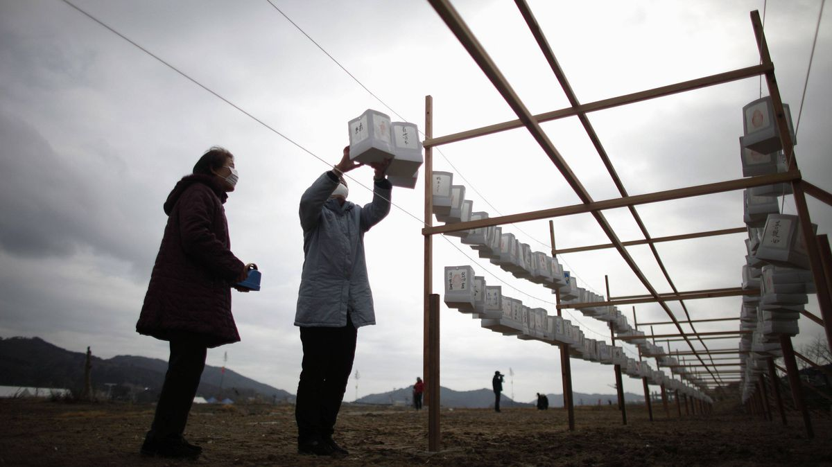 Residents in Ofunato, Iwate prefecture, hang lanterns at a memorial site in an area damaged by the 2011 earthquake and tsunami.